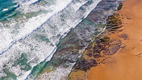 Aerial from ocean waves hitting the shore from the westcoast in. Portugal Europe Stock Photos