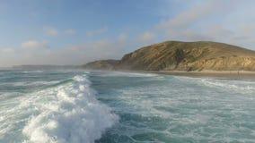 Aerial from ocean waves in Portugal stock video footage