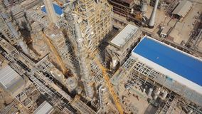 Aerial of oil refinery plant under construction 50p stock video footage