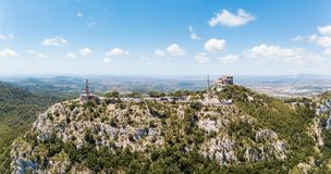 Aerial: The old benedictine monastery in Mallorca, Spain. Aerial: The old monastery on the Saint Salvador mountain in Mallorca, Spain Royalty Free Stock Image