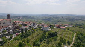 AERIAL: Old town on a hill with tower amongst the wine country stock video