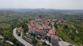 AERIAL: Old town with tower in wine country stock footage