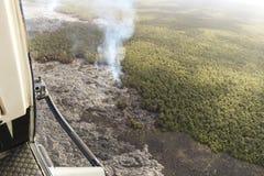 Aerial helicopter view of lava field near Kilauea volcano, Big Island, Hawaii. Aerial open helicopter shot of a lava field near the Kilauea volcano, Big Island Stock Photos