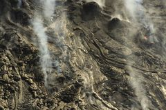 Aerial helicopter view of lava field near Kilauea volcano, Big Island, Hawaii. Aerial open helicopter shot of a lava field near the Kilauea volcano, Big Island Royalty Free Stock Images