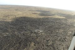 Aerial helicopter view of lava field near Kilauea volcano, Big Island, Hawaii. Aerial open helicopter shot of a lava field near the Kilauea volcano, Big Island Royalty Free Stock Photography