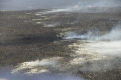 Aerial helicopter view of lava field near Kilauea volcano, Big Island, Hawaii. Aerial open helicopter shot of a lava field near the Kilauea volcano, Big Island Royalty Free Stock Image