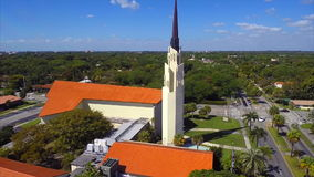 Aerial orbiting church cross stock footage