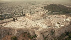 Aerial orbiting shot of the famous Parthenon temple and Acropolis. Athens, Greece