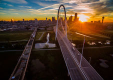 Aerial Over Bridges Dallas Texas Dramatic Sunrise Margaret Hunt Hill Bridge and Reunion Tower. Aerial Over Bridges dramatic sunrise pink clouds with City lights Stock Photo