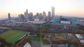 Aerial over Charlotte North Carolina during sunrise stock video footage