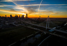 Aerial Over Dallas Texas Dramatic Sunrise Margaret Hunt Hill Bridge and Reunion Tower. The skyline cityscape highway system bridging over Trinity River Royalty Free Stock Photos
