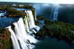 Aerial over the Falls at Iguazu. Cascading water over the majestic Iguazu Falls; from Brazil looking into Argentina Stock Photography