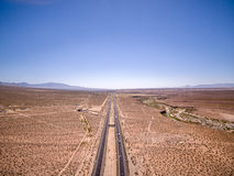 Aerial over highway through desert