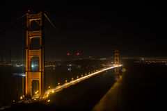 Aerial over illuminated Golden Gate Bridge a night Royalty Free Stock Images