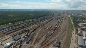 Aerial over the railway hub, showing the fork of the railway tracks. For freight trains. View from above. The drone moves slowly, showing the railroad tracks stock video footage