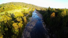 Aerial over the river in forest. Aerial shot of Green Valley during with River, autumn in Bieszczady, Poland stock footage