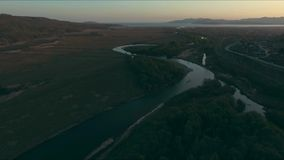 Aerial over the river and railway. Drone view of the river and railway stock video footage