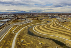 Aerial over roads in Denver, Colorado. Aerial view of roads leading into Denver, Colorado with Rocky Mountains on horizon Royalty Free Stock Photos