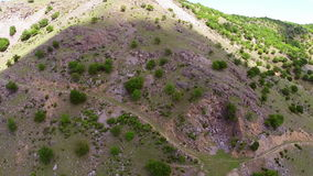 Aerial over a rock covered mountain ridge stock video footage