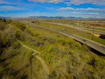 Highway I70, Arvada, Colorado. Aerial over traffic on Highway I70 in rural Arvada, Colorado on sunny day Royalty Free Stock Photo