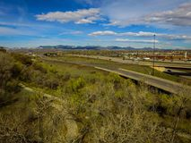 Highway I70, Arvada, Colorado with Mountains. Aerial over traffic on Highway I70 in rural Arvada, Colorado on sunny day with mountains in the background Stock Photos