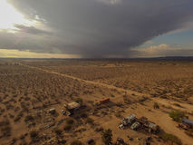 Aerial over trailer homes in Mojave. With rainstorm in the distance Royalty Free Stock Photos