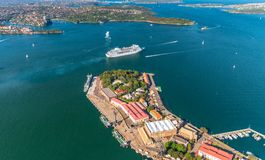 Aerial overhead view of Garden Island in Sydney with leaving cru. Ise ship, Australia Royalty Free Stock Photo