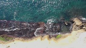 Aerial overhead view of mediterranean sea waves crashing on rocky shorecoast. Aerial overhead view of mediterranean sea waves reaching and crashing on rocky stock video