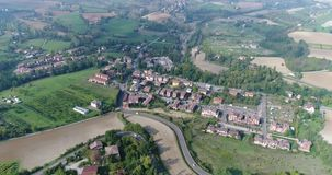 Aerial overhead view of the vineyards of Italy, small medieval town of Italy, Panoramic view from above of the vineyards. Of Italy, top view stock video footage