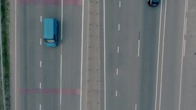 Aerial overlooking the hiway with cars, trucks and other transport. Shoot from drone. FullHD video stock video footage