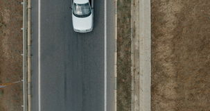 Aerial overlooking the hiway with cars, trucks and other transport. Aerial top view on the highway with cars, trucks and other transport. Shoot from drone. 4K stock footage