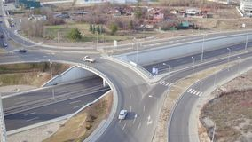 Aerial overview of traffic intersection on major freeway, white road markings on asphalt of autobahn stock video footage
