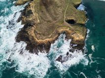 Aerial of Pacific Ocean and Mendocino Coastline in California. The cold waters of the Pacific Ocean wash against the beautiful coastline of Mendocino in northern stock photo