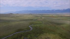 Aerial pan of fields in rural Colorado. Aerial pan of stream through field in plains of rural Colorado stock video