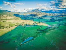 Aerial panorama of agricultural fields, meadows, and pastures at sunset. Aerial panorama of agricultural fields, meadows, and pastures at sunset Stock Photo