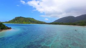 Aerial panorama of Anse L`Islet, Port Glaud, Mahe Island, Seychelles 2. Drone shot panorama of Port Glaud, Mahe Island, Seychelles stock footage