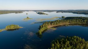 Aerial panorama of beautiful islands and the beach on the lake Mammenselka. Finland stock images