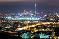 Aerial panorama of busy Taipei City, Keelung River, Dazhi Bridge, Songshan Airport & Taipei landmark in XinYi District at dusk. Aerial panorama of busy Taipei Royalty Free Stock Photo