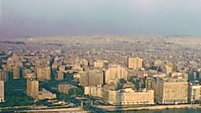 Archival panorama from Cairo tower. Aerial panorama of the Cairo streets and Qasr al-Nil Bridge. Ancient traffic with vintage cars. Archival from Cairo tower of stock video footage