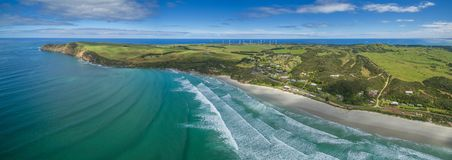 Aerial panorama of Cape Bridgewater beach, settlement, and wind farm in Victoria, Australia. Aerial panorama of Cape Bridgewater beach, settlement, and wind Royalty Free Stock Images
