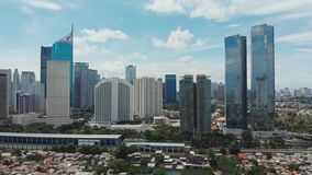 Aerial panorama of the city center with skyscrapers Jakarta. Indonesia. Aerial panorama of the city center with skyscrapers Jakarta. Indonesia stock footage