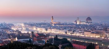AERIAL. Panorama of the city of FLORENCE in Italy with the dome and Palazzo della Signoria and arno river royalty free stock photography