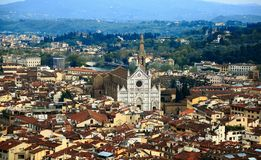 Aerial panorama of Florence old town from the top of Florence Cathedral Il Duomo di Firenze with a view of crowded houses royalty free stock images