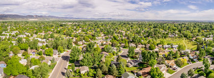 Aerial panorama of Fort Collins. With downtown and Rocky Mountains in a distance, late spring scenery Royalty Free Stock Images