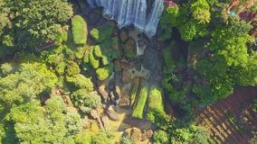 Aerial panorama giant waterfall streams from cliff stock video footage
