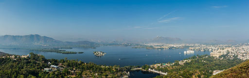 Aerial panorama of Lake Pichola with Lake Palace (Jag Niwas) and Royalty Free Stock Photo