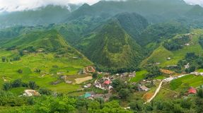 Aerial panorama landscape of mountain valley village and rice te royalty free stock photo