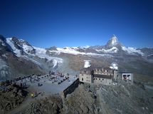 Aerial panorama of majestic mountain Matterhorn in morning sunlight with the famous Gornergrat Observatory Royalty Free Stock Image