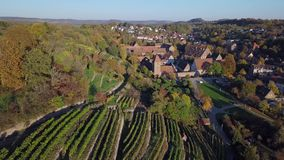 Aerial panorama of Maulbronn old town and vineyards, Germany. Flight over Maulbronn old town and vineyards, Baden-Wurttemberg, Germany stock video footage