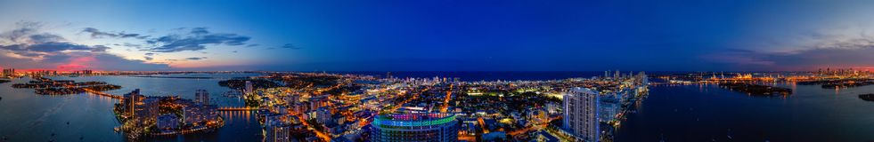 Aerial panorama Miami Beach twilight with neon city lights royalty free stock photography